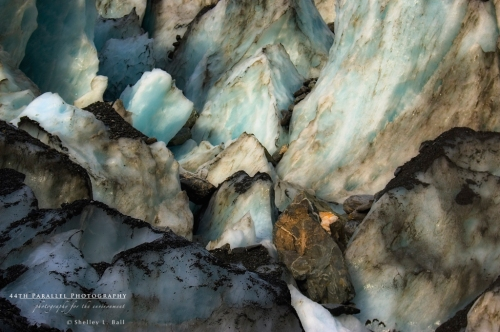 Glacier ice and rubble - the soil, rocks and material that get dragged along at the glacier moves.